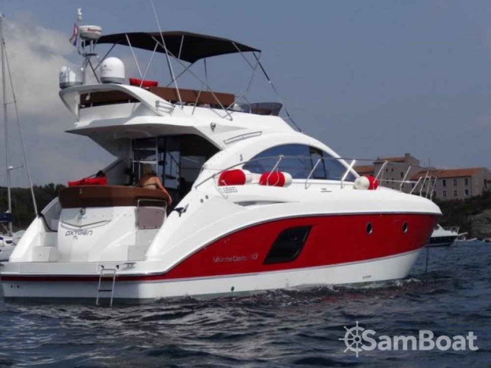 Rental Motor boat in Antibes - Bénéteau Monte Carlo 47 Fly
