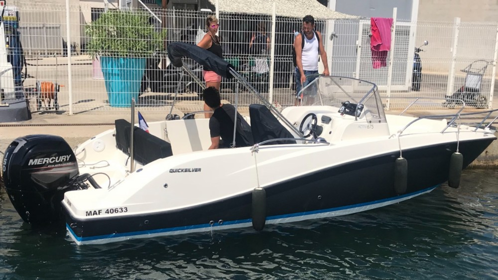 Rent a Quicksilver Activ 675 Sundeck Cogolin