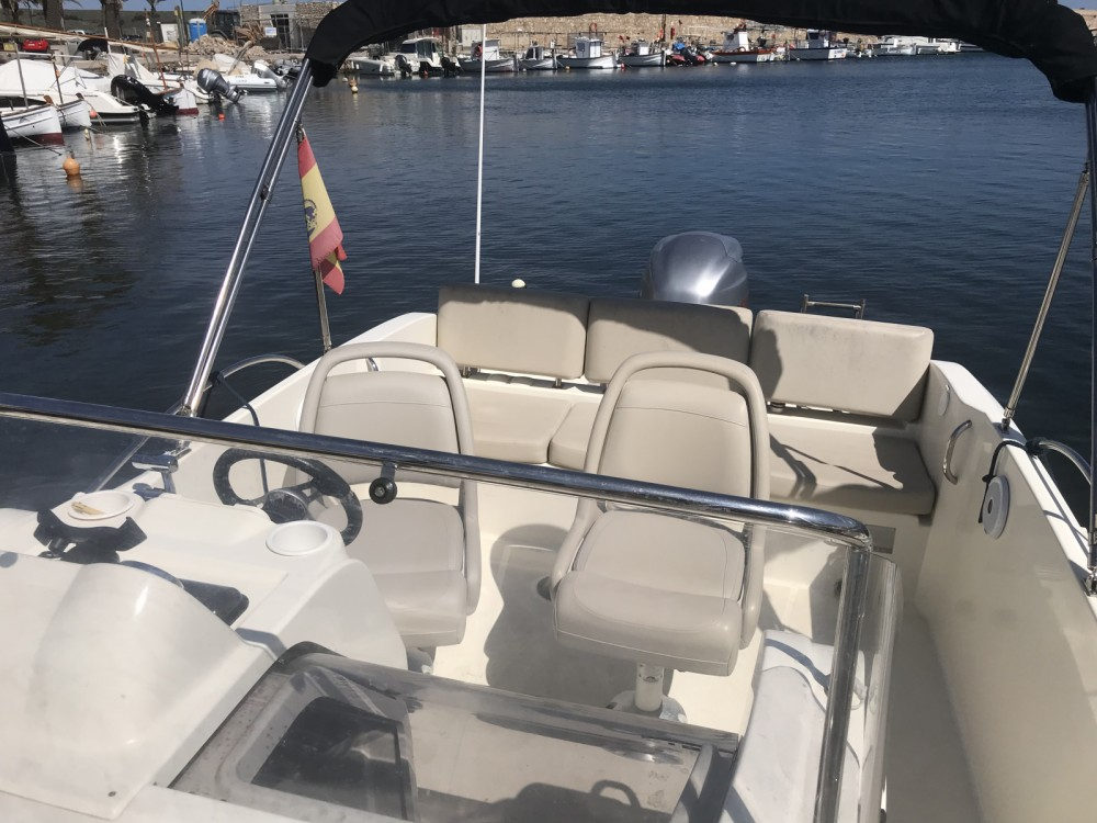 Motorboat for rent es Migjorn Gran at the best price