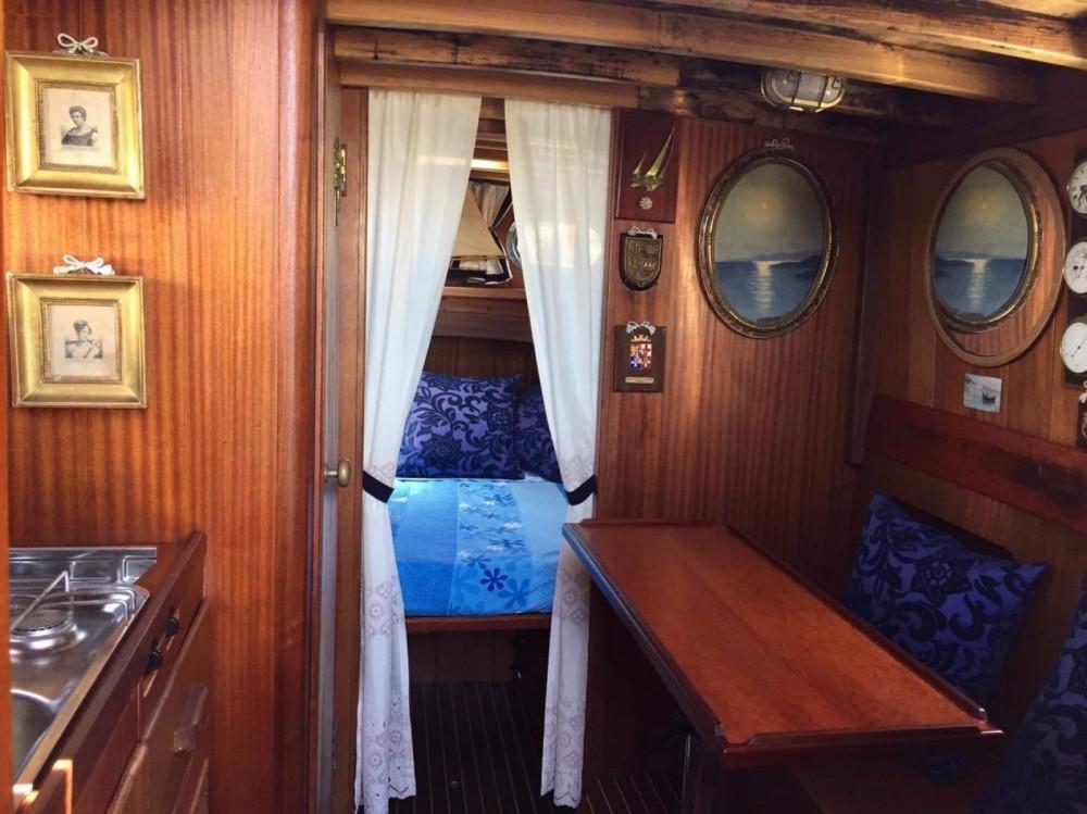Boat rental Porto Azzurro cheap Gozzo cabinato legno