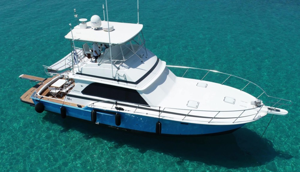 Rent a Bertram 46.6 convertible flybridge Ormos Panagias