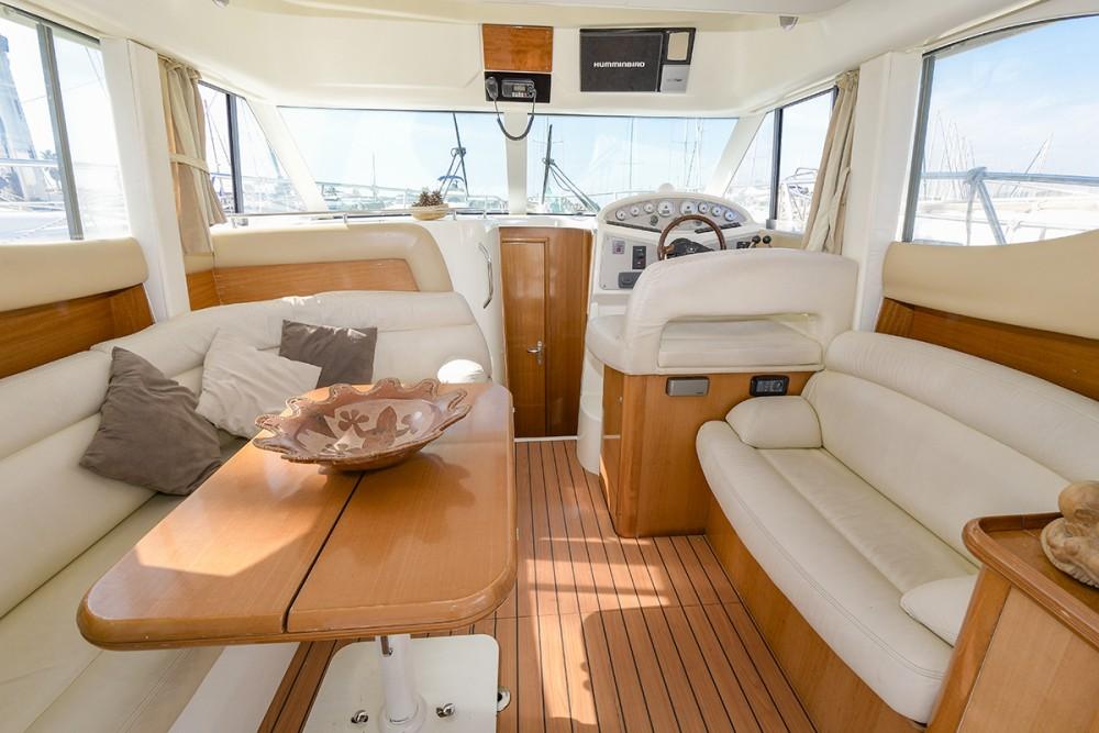 Boat rental Jeanneau Prestige 32 in Port esportiu d'Aiguadolç on Samboat