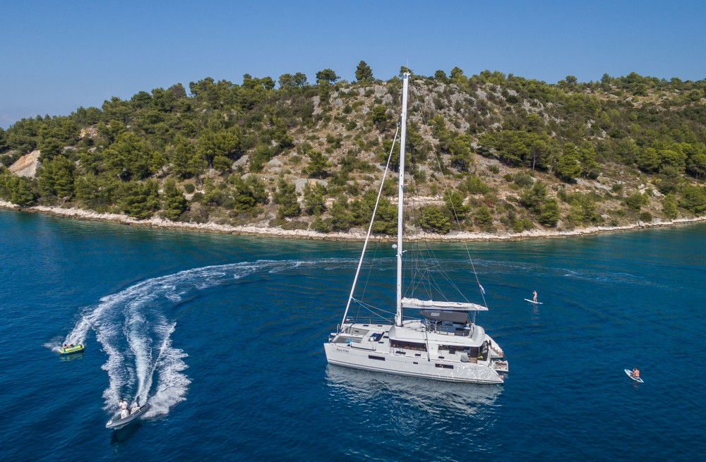 Rent a Lagoon Lagoon 560 S2 (2016) equipped with generator, AC (saloon+cabins), water maker, ice maker, microwave oven, dishwasher, underwater lights, 2 X S.U.P. , water ski & tube, 8 snorkel. sets Split