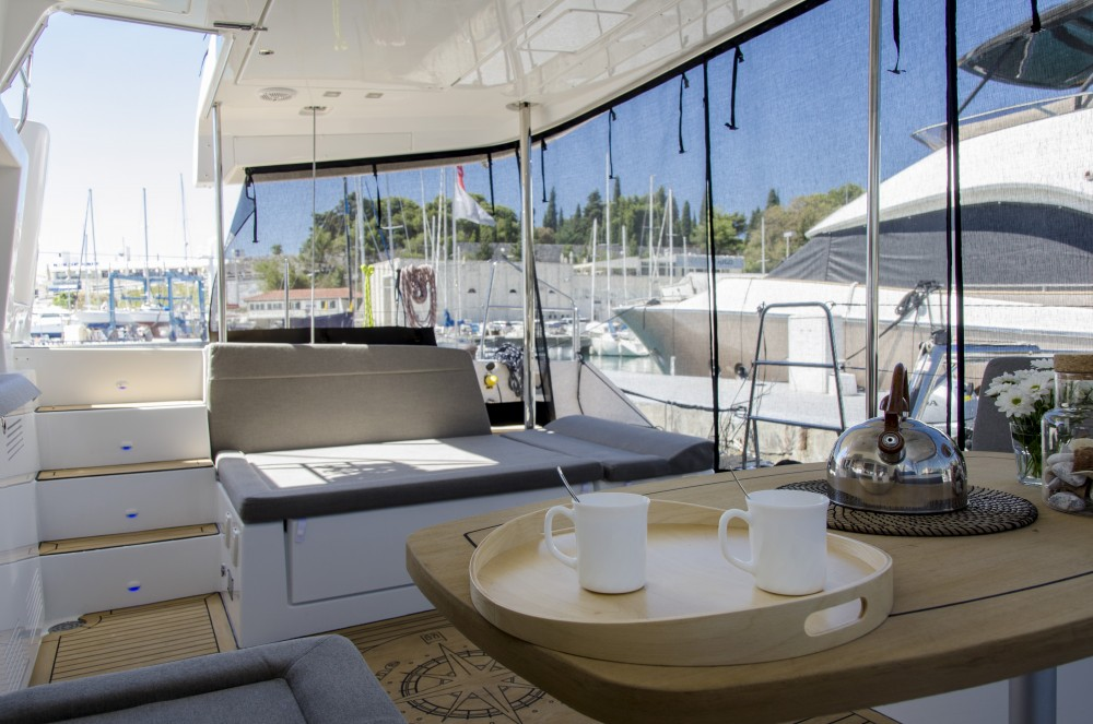Rental Catamaran in Split - Lagoon Lagoon 450 F (2016)equipped with generator, A/C (saloon+cabins), ice maker, dishwasher,water maker, microwave oven,  2 S.U.P.2 kneeboard, underwater lights, bow thruster