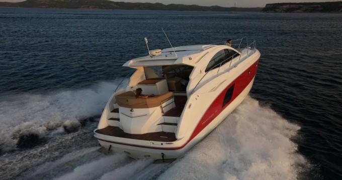 Rental Motorboat in Taranto - Bénéteau Monte Carlo 47 Sport Top